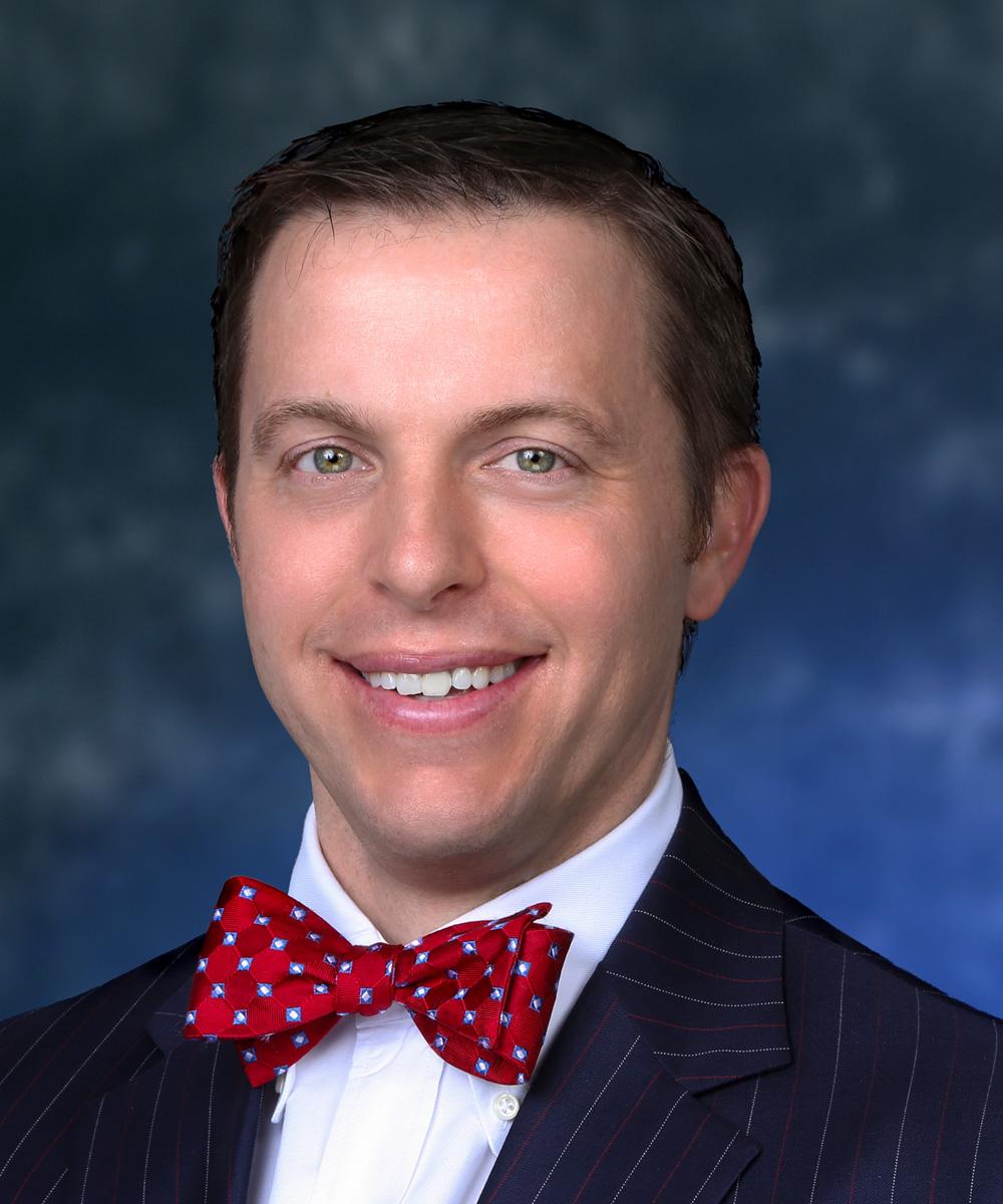 Luke Madigan, M.D.